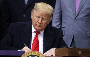 ASSOCIATED PRESS                                 President Donald Trump signed a new North American trade agreement with Canada and Mexico, during an event at the White House, today, in Washington.