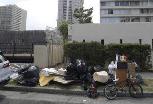 BRUCE ASATO / BASATO@STARADVERTISER.COM                                 A pile of bulky items and regular trash sat on a sidewalk in the 430 block of Nohonani Street in Waikiki on July 8.