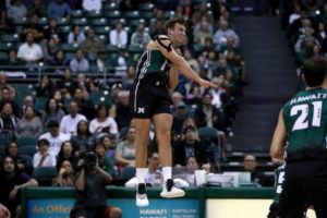 ANDREW LEE / SPECIAL TO THE HONOLULU STAR-ADVERTISER                                 Hawaii's Colton Cowell (17) hits the ball during the second set of a NCAA Men's Volleyball match against Harvard on Friday at the Stan Sheriff Center. Hawaii is retaining the same ranking as they had in the preseason coaches men's volleyball poll.