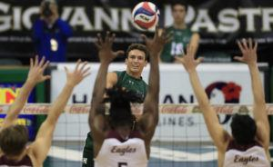 JAMM AQUINO / JAQUINO@STARADVERTISER.COM                                 Hawaii outside hitter Colton Cowell puts down a kill against the Charleston Golden Eagles during the first set.