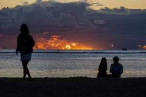 DENNIS ODA / DODA@STARADVERTISER.COM                                 People enjoyed the weather and sunset at Ala Moana Beach in January. It is shaping up to be a warm winter.
