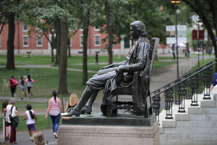 ASSOCIATED PRESS                                 The statue of John Harvard sits in Harvard Yard at Harvard University in Cambridge, Mass.