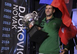 ASSOCIATED PRESS                                 Serbia's Novak Djokovic carries the Norman Brookes Challenge Cup onto Margaret Court Arena to celebrate with fans after defeating Austria's Dominic Thiem in the men's singles final of the Australian Open tennis championship in Melbourne, Australia.