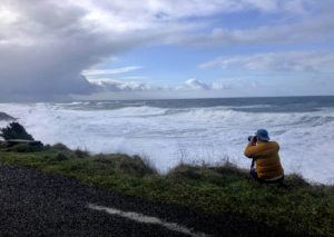 ASSOCIATED PRESS                                 A man photographed waves crashing onto the cliffs at Rodea Point, Jan. 11, in Lincoln County, Ore. during an extreme high tide that coincided with a big winter storm.