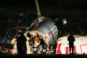 ASSOCIATED PRESS                                 Rescue members and firefighters work after a plane skidded off the runway at Istanbul's Sabiha Gokcen Airport, in Istanbul, today. The plane skidded off the runway, crashing into a field and breaking into pieces. Authorities said at least 52 people were injured, and passengers were seen evacuating through the cracks in the plane.