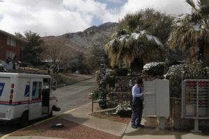 ASSOCIATED PRESS                                 Snow was seen on palm trees while mail carrier Pablo Salinas delivered letters, today, in El Paso, Texas. Salinas said his commute took an extra hour due to road closures following four inches of snow falling overnight.