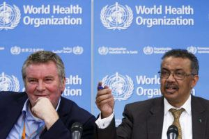 KEYSTONE VIA ASSOCIATED PRESS                                 Tedros Adhanom Ghebreyesus, Director General of the World Health Organization, right, is flanked by Michael Ryan, left, Executive Director of WHO's Health Emergencies program, during a press conference at the World Health Organization headquarters in Geneva, Switzerland, today. Ghebreyesus urged countries outside China to share more data on infections, saying detailed information has been provided in only 38% of cases.