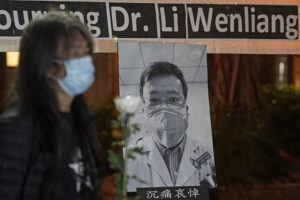ASSOCIATED PRESS Pro-democracy activist Leung Kwok-hung, wearing a mask, attended a vigil for Chinese doctor Li Wenliang, in Hong Kong, Friday. The death of a young doctor who was reprimanded for warning about China's new virus triggered an outpouring Friday of praise for him and fury that communist authorities put politics above public safety.