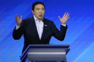 ASSOCIATED PRESS                                 Democratic presidential candidate entrepreneur Andrew Yang speaks during a Democratic presidential primary debate at Saint Anselm College in Manchester, N.H., on Friday.