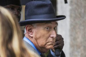 ASSOCIATED PRESS / 2019                                 Roger Stone, a longtime Republican provocateur and former confidant of President Donald Trump, waits in line at the federal court in Washington.