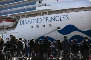 ASSOCIATED PRESS                                 Media gathered outside the quarantined Diamond Princess cruise ship in Yokohama, near Tokyo, Tuesday. Japan's Health Minister Katsunobu Kato said the government was considering testing everyone remaining onboard and crew on the Diamond Princess, which would require them to remain aboard until results were available.