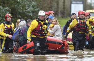 "ASSOCIATED PRESS                                 Rescue operations continue as emergency services take residents to safety, in Nantgarw, Wales, today. Storm Dennis is roaring across Britain with high winds and heavy rains, prompting authorities to issue 350 flood warnings, including a ""red warning"" alert for life-threatening flooding in south Wales."