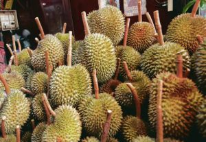 ASSOCIATED PRESS / SEPTEMBER 2019 Hawaii island police are investigating the theft of fruit valued at about $1,000 including durians, which have a pungent fragrance. On Feb. 1, two men entered a Hilo property and removed 18 durian and other types of fruit, police said. Durians for sale in Bangkok are pictured.