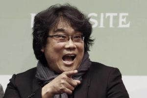 """ASSOCIATED PRESS                                 Bong Joon-ho, director of Oscar-winning """"Parasite,"""" gestured during a press conference in Seoul, Wednesday. Bong said Wednesday """"the biggest pleasure and the most significant meaning"""" that the film has brought to him was its success in many countries though the audiences might feel uncomfortable with his explicit description of a bitter wealth disparity in modern society."""