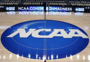 ASSOCIATED PRESS                                 The NCAA logo was displayed, in March 2015, at center court as work continued at The Consol Energy Center in Pittsburgh, for the NCAA college basketball tournament. The NCAA took a significant step toward allowing all Division I athletes to transfer one time without sitting out a season of competition.