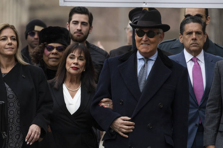 ASSOCIATED PRESS                                 Roger Stone was accompanied by his wife Nydia Stone, second from left, arrives at federal court in Washington, today. Stone, a staunch ally of President Donald Trump, was sentenced today on his convictions for witness tampering and lying to Congress.