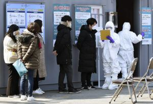LEE MOO-RYUL/NEWSIS VIA ASSOCIATED PRESS                                 People suspected of being infected with the new coronavirus waited to receive tests at a medical center in Daegu, South Korea, Thursday. The mayor of the South Korean city of Daegu urged its 2.5 million people on Thursday to refrain from going outside as cases of a new virus spiked and he pleaded for help from the central government.