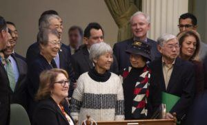 PAUL KITAGAKI JR./THE SACRAMENTO BEE VIA ASSOCIATED PRESS                                 Assemblyman Al Muratsuchi, D-Torrance, in back, joined Japanese Americans who were incarcerated during World War II after the California Assembly passed House Resolution 77, today, in Sacramento. Muratsuchi is the author of the resolution, which apologizes for the state's role in supporting the internment and its failure to protect the civil rights of citizens of Japanese ancestry.