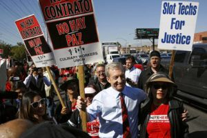 ASSOCIATED PRESS                                 Democratic presidential candidate, businessman Tom Steyer walks on a picket line with members of the Culinary Workers Union Local 226 outside the Palms Casino in Las Vegas on Wednesday.