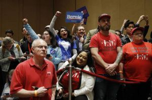 ASSOCIATED PRESS                                 Supporters of Democratic presidential candidate Sen. Bernie Sanders, I-Vt., cheer as members of the Culinary Workers Union watch during a Democratic presidential caucus at the Bellagio hotel-casino in Las Vegas.