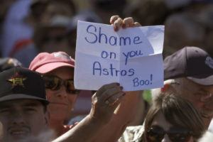 ASSOCIATED PRESS                                 A fan holds a sign during a spring training baseball game between the Houston Astros and the Washington Nationals on Feb. 23 in West Palm Beach, Fla.