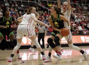 ASSOCIATED PRESS                                 Oregon's Sabrina Ionescu looks to shoot between Stanford's Ashten Prechtel (11) and Lexie Hull, right, in the first half.
