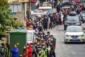 CHINATOPIX VIA ASSOCIATED PRESS                                 People lined up to buy face masks, Jan. 29, from a medical supply company in Nanning in southern China's Guangxi Zhuang Autonomous Region. Fear of the spreading coronavirus has led to a global run on sales of face masks despite medical experts' advice that most people who aren't sick don't need to wear them.