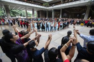 CINDY ELLEN RUSSELL / CRUSSELL@STARADVERTISER.COM                                 Hawaiians gathered for morning protocol at the state Capitol on the opening day of the legislature. Hundreds of opponents to the Thirty Meter Telescope held hands in unity on the ground floor. A panel of Hawaii lawmakers today passed a resolution calling for the governor to convene a Native Hawaiian reconciliation commission.