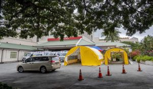 "DENNIS ODA /DODA@STARADVERTISER.COM                                 Tents were put up outside the Queen's Medical Center emergency entrance to evaluate and potentially test ""walking well"" patients for the novel coronavirus while keeping them separated from emergency room patients."
