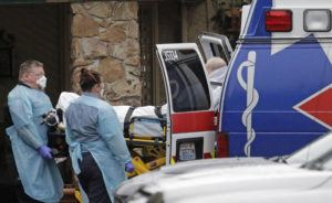 ASSOCIATED PRESS                                 Ambulance workers move a man on a stretcher from the Life Care Center in Kirkland, Wash. into an ambulance. The facility is the epicenter of the outbreak of the the COVID-19 coronavirus in Washington state.