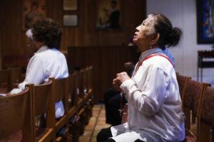 OCTAVIO JONES/TAMPA BAY TIMES VIA AP Esther Gianan, of Tampa, a retired registered nurse, prays for those who are affected by the coronavirus during Mass at St. Lawrence Catholic Church in Tampa, Fla.