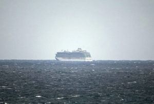 ASSOCIATED PRESS                                 The Regal Princess Cruise ship is seen at sea about 5 miles off the coast of Fort Lauderdale, Fla., Sunday. The cruise ship was being held off the coast of Florida Sunday as the ship waits for test results on whether two crew members have contracted the new coronavirus.