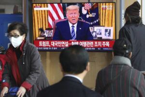 ASSOCIATED PRESS                                 People watched a TV screen showing a live broadcast of President Donald Trump's speech at the Seoul Railway Station in Seoul, South Korea, Thursday. Trump announced he is cutting off travel from Europe to the U.S. and moving to ease the economic cost of a viral pandemic that is roiling global financial markets and disrupting the daily lives of Americans.