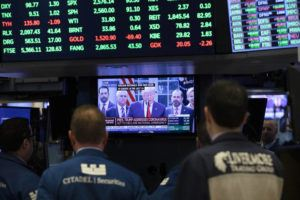 ASSOCIATED PRESS                                 Traders listen at the New York Stock Exchange to President Donald Trump's televised speech from the White House, today in New York.