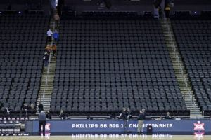 ASSOCIATED PRESS                                 Fans leave the Sprint Center after the remaining NCAA college basketball games after in the Big 12 Conference tournament were canceled due to concerns about the coronavirus on Thursday in Kansas City, Mo.