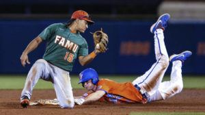 ASSOCIATED PRESS                                 Florida's Brock Edge, right, steals second base, beating the tag by Florida A&M infielder Octavien Moyer during a game on March 4.
