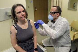 ASSOCIATED PRESS                                 A pharmacist gave Jennifer Haller, left, the first shot in the first-stage safety study clinical trial of a potential vaccine for COVID-19, the disease caused by the new coronavirus, today, at the Kaiser Permanente Washington Health Research Institute in Seattle.