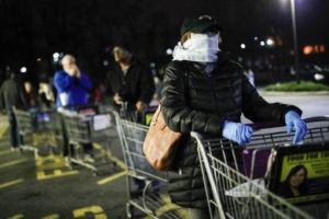 ASSOCIATED PRESS                                 Customers wearing protective masks and gloves waited in line at a Stop & Shop supermarket that opened special morning hours to serve people 60-years and older due to coronavirus concerns, today, in Teaneck, N.J. For most people, COVID-19, the disease caused by the new coronavirus, causes only mild or moderate symptoms, such as fever and cough. For some, especially older adults and people with existing health problems, it can cause more severe illness, including pneumonia.