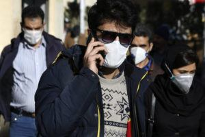 ASSOCIATED PRESS                                 A man wearing a face mask, to help protect against the new coronavirus, spoke on his cellphone in downtown Tehran, Iran, earlier this month.