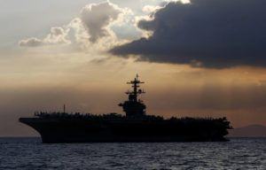 ASSOCIATED PRESS                                 The USS Theodore Roosevelt aircraft carrier was anchored off Manila Bay west of Manila, Philippines, in April 2018. The captain of the U.S. Navy aircraft carrier faceing a growing outbreak of the coronavirus is asking for permission to isolate the bulk of his roughly 5,000 crew members on shore, which would take the warship out of duty in an effort to save lives. The ship is docked in Guam.
