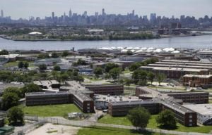 ASSOCIATED PRESS / 2014                                 The Rikers Island jail complex stands in New York with the Manhattan skyline in the background. Jail operators in the U.S. are coming to the growing realization that it's only a matter of time before coronavirus strikes here.
