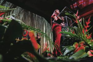 """CINDY ELLEN RUSSELL / 2019                                 Sarah Bilyeu, daughter of Malani Bilyeu, a founding member of Kalapana who died in December, spoke at the 42nd Na Hoku Hanohano Awards while receiving the Anthology Album of the Year Award for """"Kalapana: The Original Album Collection"""" at the Hawai'i Convention Center in 2019. Next to her is Kalapana member DJ Pratt."""