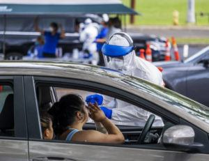 DENNIS ODA / DODA@STARADVERTISER.COM                                 Premier Medical Group Hawaii conducted drive-thru testing at Kakaako Waterfront Park on March 21.