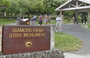 BRUCE ASATO / BASATO@STARADVERTISER.COM                                 Visitors walk down the summit trail of Diamond Head State Monument on Nov. 19, 2019.