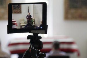 ASSOCIATED PRESS / APRIL 3 A tablet livestreams the funeral of J. Robert Coleman in Lexington, S.C. Following CDC guidelines during the coronavirus outbreak, Thompson Funeral Homes asked Coleman's family to invite fewer than 10 people to his service.