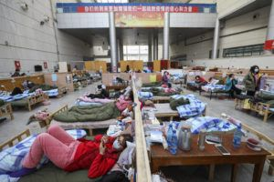 ASSOCIATED PRESS / FEB. 21                                 Patients rested at a temporary hospital at Tazihu Gymnasium in Wuhan in central China's Hubei province.
