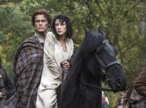 """COURTESY SONY PICTURES TELEVISION                                 Caitriona Balfe as Claire Randall, right, and Sam Heughan as Jamie Fraser, in a scene from Starz' TV series, """"Outlander."""" Heughan spoke out on social media about what he calls """"six years of constant bullying, harassment, stalking and false narratives."""""""