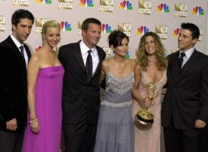 """ASSOCIATED PRESS / SEPT. 2002                                 The cast of """"Friends,"""" from left, David Schwimmer, Lisa Kudrow, Matthew Perry, Courteney Cox, Jennifer Aniston and Matt LeBlanc posed in the press room with the award for outstanding comedy series at the 54th annual Primetime Emmy Awards in Los Angeles. Castmembers of the popular show have announced that five fans will get a chance to watch the reunion taping live and rub shoulders with stars Jennifer Aniston, Courteney Cox, Matthew Perry, Lisa Kudrow, Matt LeBlanc and David Schwimmer."""