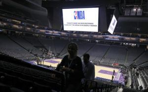 "ASSOCIATED PRESS                                 Fans leave the Golden 1 Center in Sacramento, Calif., after the NBA basketball game between the New Orleans Pelicans and Sacramento Kings was postponed at the last minute over an ""abundance of caution"" after a player for the Jazz tested positive for the coronavirus on March 11."