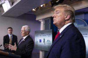 ASSOCIATED PRESS                                 President Donald Trump stands as Vice President Mike Pence speaks about the coronavirus in the James Brady Press Briefing Room of the White House in Washington on April 20.